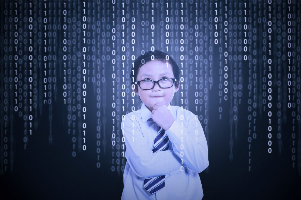 Little boy looking at binary code