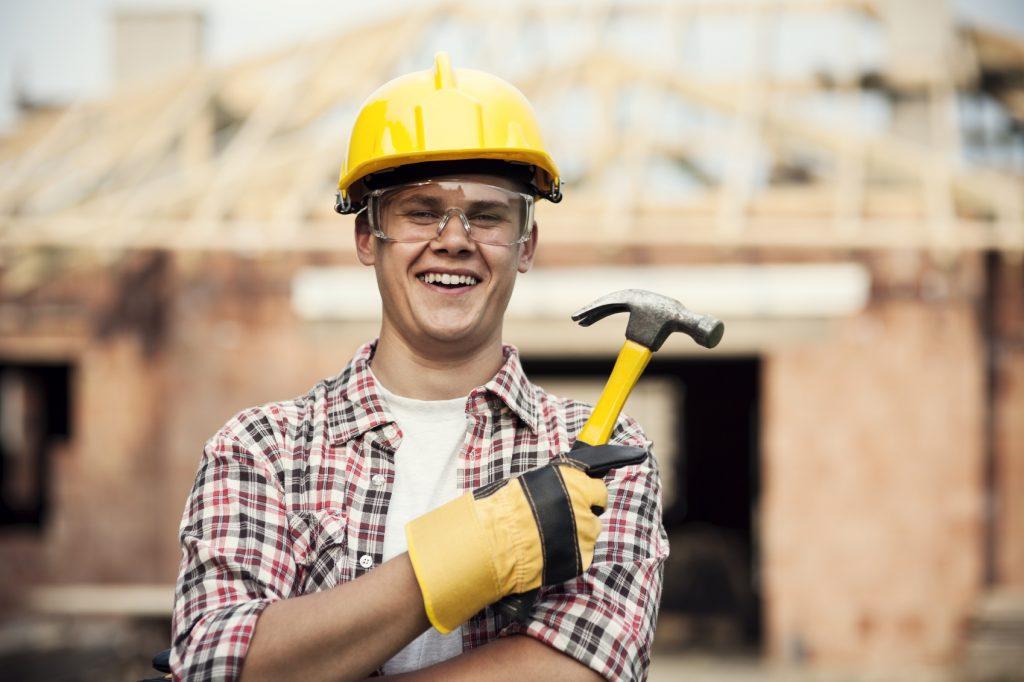 Construction worker with hammer - iStock_000020830881_Medium