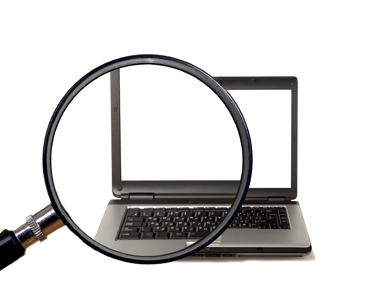 Magnifying glass magnifies laptop