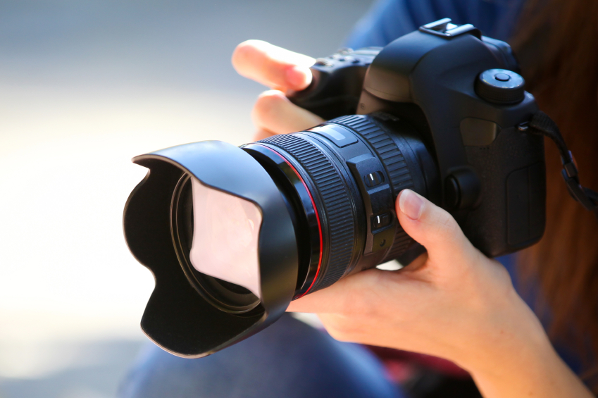 Holding a Full Frame Camera.