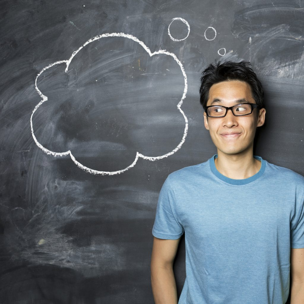 Man With Thought Bubble Next to Chalkboard - iStock_000029506162_Large