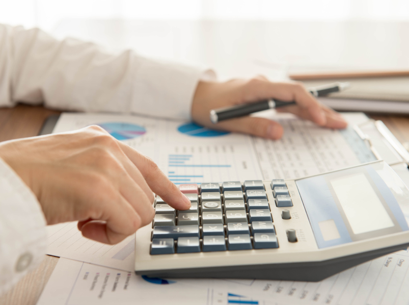 payroll worker with calculator