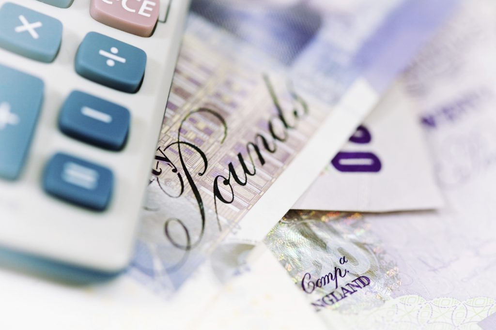 Currency and Calculator - iStock_000004142949_Medium