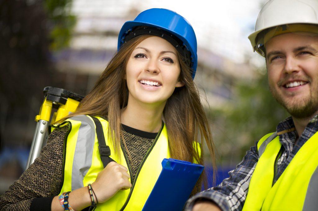 female land surveyor with male colleague