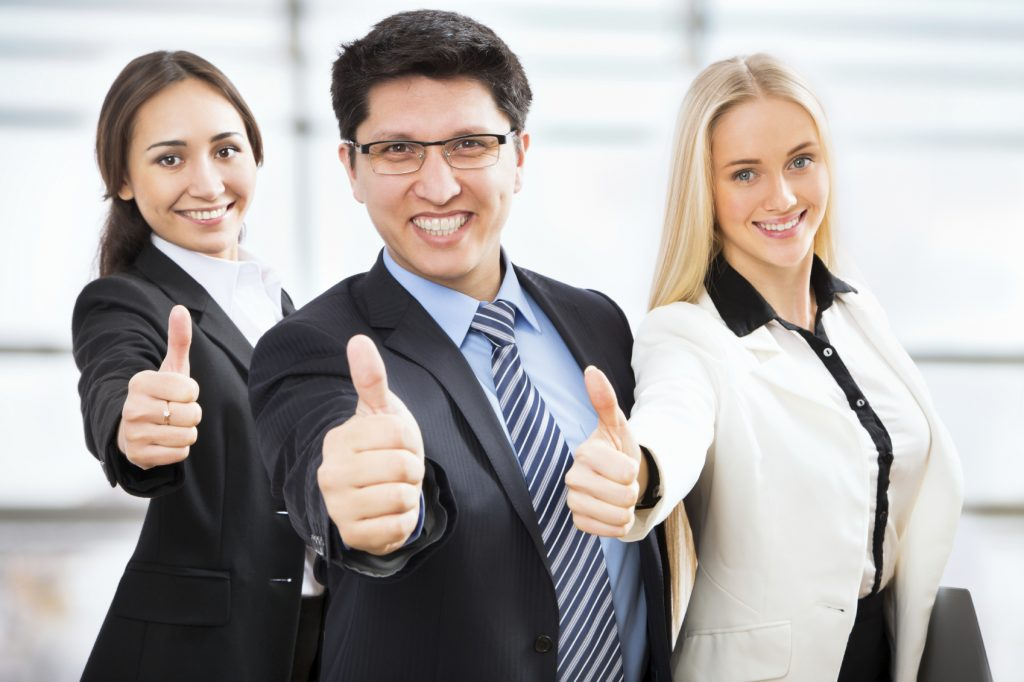 Happy business people show thumb up