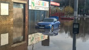 Car Floating in Floodwater