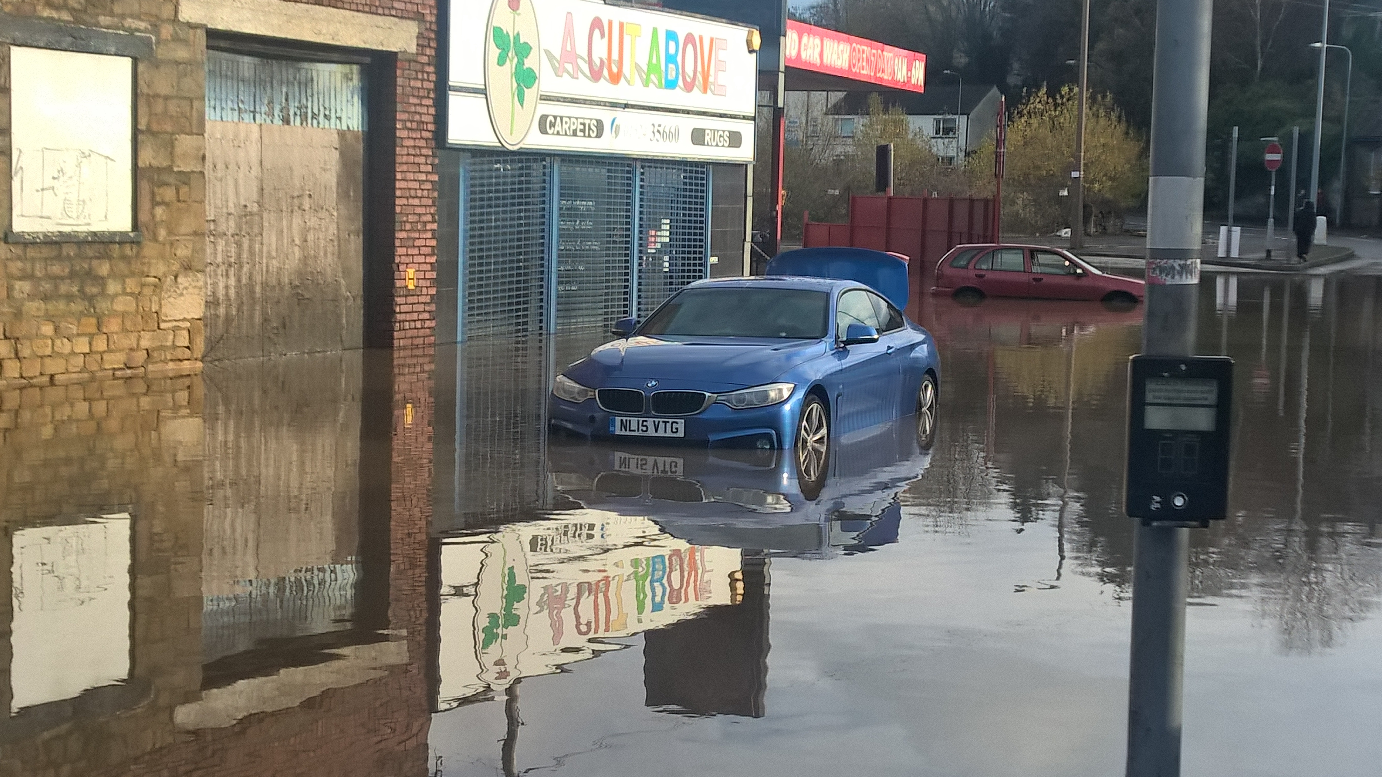 A car that was floating inthe floodwater